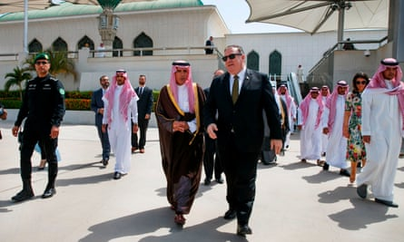 Mike Pompeo walks with the Saudi minister of state for foreign affairs, Adel al-Jubeir, at the airport as Pompeo prepares to depart Jeddah on Monday.