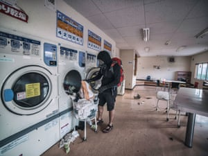 Keow's images give an eerie insight into the panic that followed the disaster and show a city stuck in time as calendars remain on the same date, families' clean washing is half-removed from driers and goods remain forever unsold