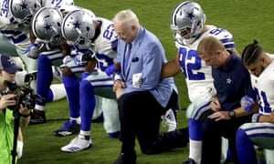 Jerry Jones kneels alongside Cowboys players before the national anthem. He has since threatened to bench any player who protests during the anthem