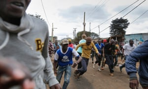 Supporters of the opposition leader flee as shots are fired by riot police during a protest in Kibera during Kenya's 2017 general elections.