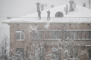 Clearing snow off a roof