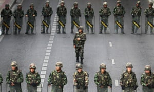 Thai soldiers guarding a bus stop area to prevent an anti-coup demonstration in Bangkok in 2014.
