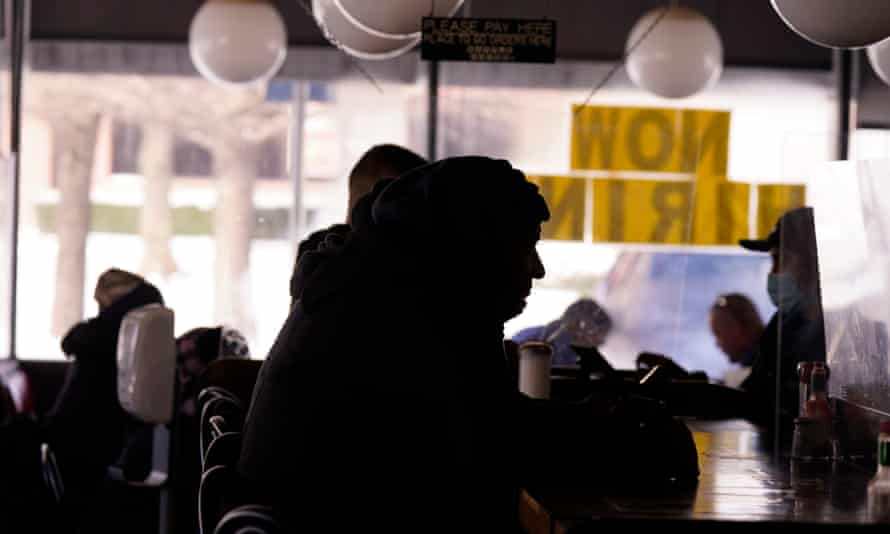Patrons sit in restaurant without power caused by cold weather blackouts in Richardson, Texas, on 16 February.