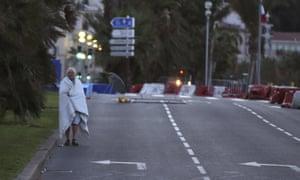 A man walks near the scene of an attack