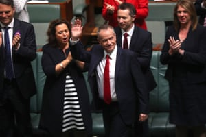 Bill Shorten waves to the galleries after delivering his budget reply speech