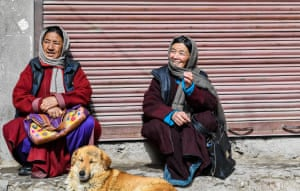 Ladakhi women are as colorful as it gets - which matches the prayer flags and adds vibrance to the harsh landscape. Here, two women sit by the streetside with their dog, in the sunshine.