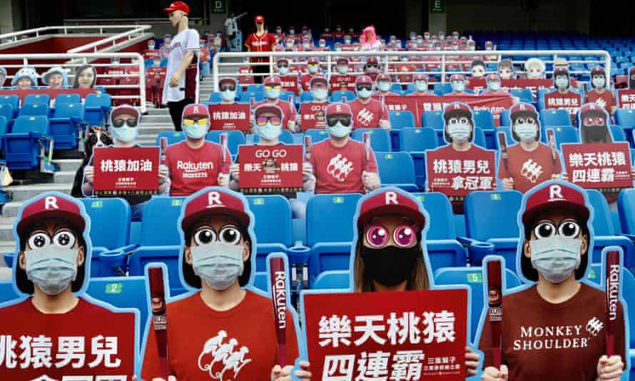 Life-size cutouts depicting spectators are seen in empty seats during a Chinese Professional Baseball League game between the Rakuten Monkeys and CTBC Brothers. They will soon be replaced by fans.