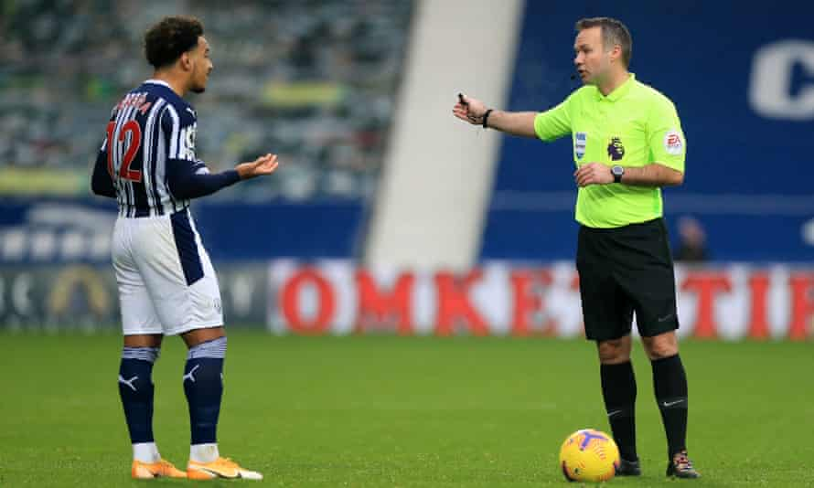 West Brom's Matheus Pereira reacts with disbelief after being sent off by Paul Tierney
