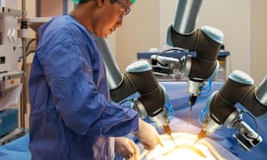 An automated robot hand being used in an operation