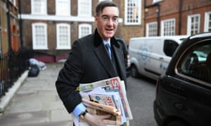 Jacob Rees-Mogg carrying newspapers in the street