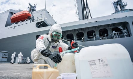 Soldiers from Taiwan's chemical units disinfecting the Panshi supply ship in Kaohsiung, south Taiwan.