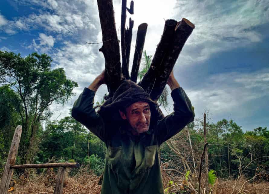 The coal producer Reinol Milian carries firewood in San Agustín