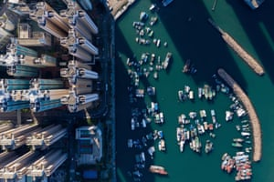 Boats moored at a typhoon shelter next to residential buildings in Hong Kong.