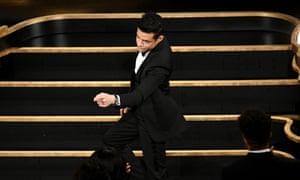 Rami Malek accepts the actor in a leading role award for Bohemian Rhapsody.