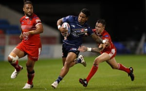 St Helens' Ben Barba attempts to evade a tackle by Salford Red Devils' Gareth O'Brien during the Betfred Super 8s match at the AJ Bell Stadium, Salford.