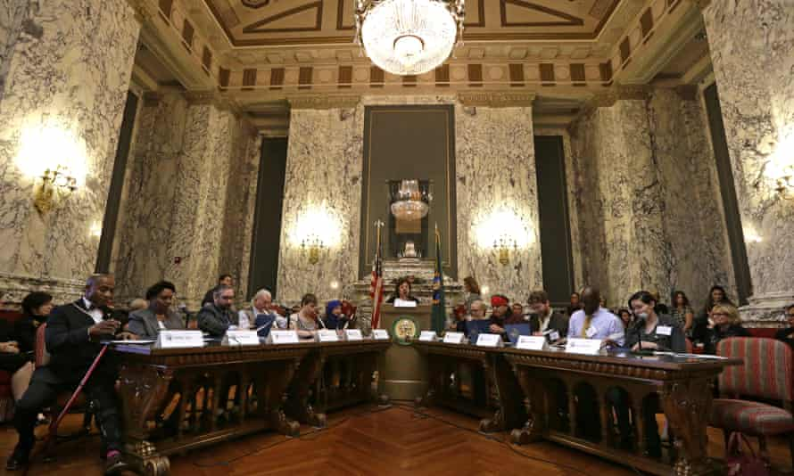 Electors fill out their ballots during a meeting of Washington state's electoral college on 19 December 2016, in Olympia, Washington.
