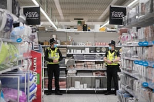 Watford, UK: Police officers patrol the Asda Watford Supercentre in Hertfordshire which is being used as a community pharmacy vaccination centre
