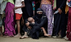 Rohingya refugees wait to receive aid in Cox's Bazar, Bangladesh.