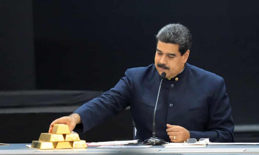 Nicolás Maduro touches a gold bar