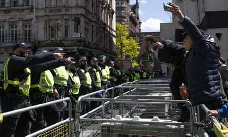Far-right protesters confront police in London on 13 June.