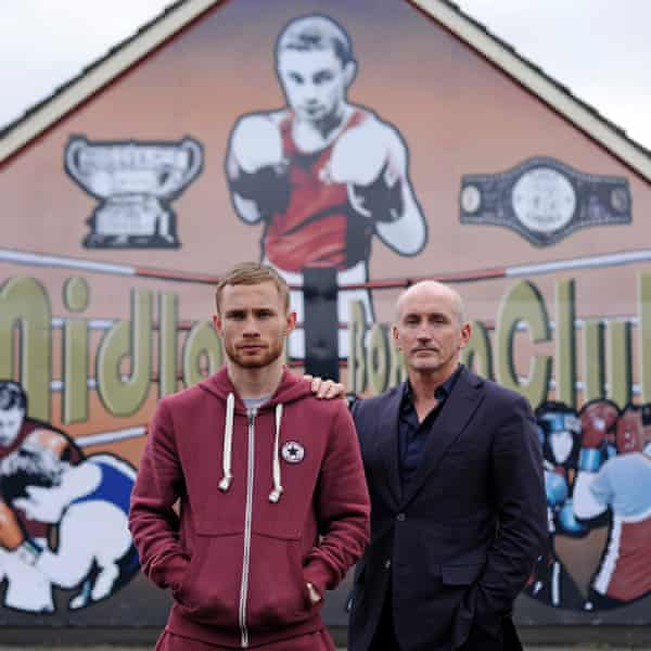 Carl Frampton with Barry McGuigan in front of his mural at the Midland Boxing Club in Tiger's Bay, Belfast, before the pair fell out.