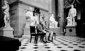Sandra Day O'Connor and Ruth Bader Ginsburg pose for a portrait 28 March 2001 surrounded by statues of men at the Capitol building.