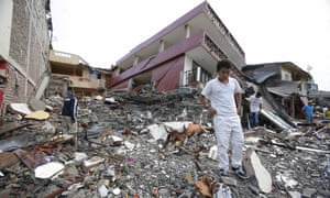 People search for their belongings amid the debris of their destroyed homes in Pedernales, on Ecuador's Pacific coast.