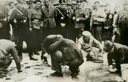 Jews scrub Vienna streets in a Nazi 'purge', 1938.