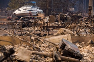 A boat remains untouched in the yard of home destroyed during the Camp Fire