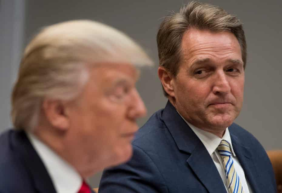 Jeff Flake listens as Donald Trump speaks at the White House on 5 December 2017.