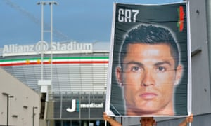 A fan holds up a banner welcoming Cristiano Ronaldo to his medical at Juventus.