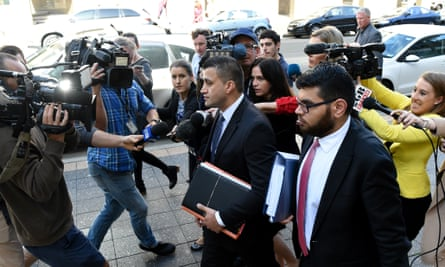 Zemarai Khatiz (centre), the lawyer representing a 16-year-old Auburn boy accused of trying to obtain a gun to use in an Anzac Day attack, leaves the Parramatta children's court in Sydney on Tuesday.