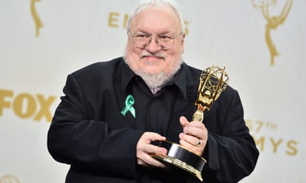 Don't forget your readers, Mr Martin ... the author celebrating his Emmy award for the HBO Game of Thrones adaptation in 2015.