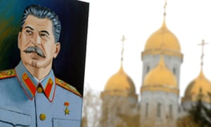 A portrait of Josef Stalin against an Orthodox cathedral at the memorial built to honour those who died in the Battle of Stalingrad.