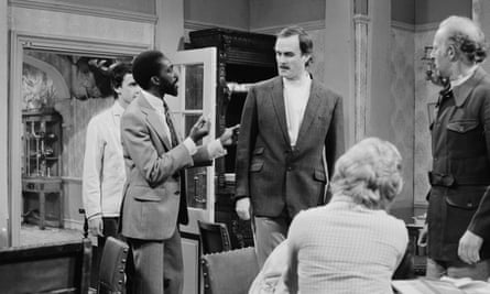 Louis Mahoney, second from left, with John Cleese, centre, in The Germans, an episode of the BBC sitcom Fawlty Towers, 1975.