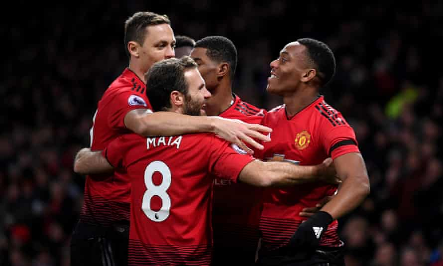 Anthony Martial (right) celebrates with teammates after scoring his team's second goal.