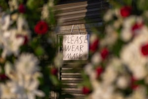 Signage requires masks at a business in the flower district in Skid Row reopening in time for Mother's Day on May 8, 2020 in Los Angeles, California.
