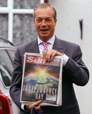 Former Ukip leader Nigel Farage displays the Sun's front page as the voters go the polls in the EU referendum in June 2016