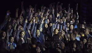 Fans raise their fists during a dedication ceremony for the new attraction