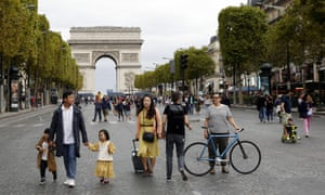 People walk on the Champs Élysées during World Car-free Day in Paris.
