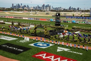 A general view as the jockeys line up for the national anthem ahead of race 7 the Lexus Melbourne Cup.
