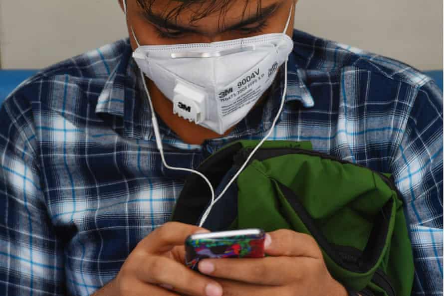 A man wears a face mask in Mumbai.