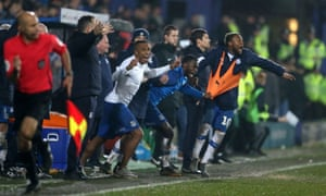 The Tranmere bench erupts at the final whistle.