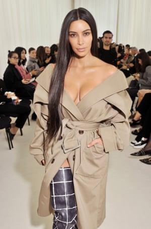 Kim Kardashian in a trench at the Balenciaga show in 2016.