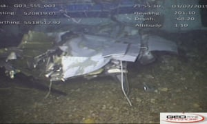 Underwater wreckage of the Piper Malibu aircraft on the seabed.