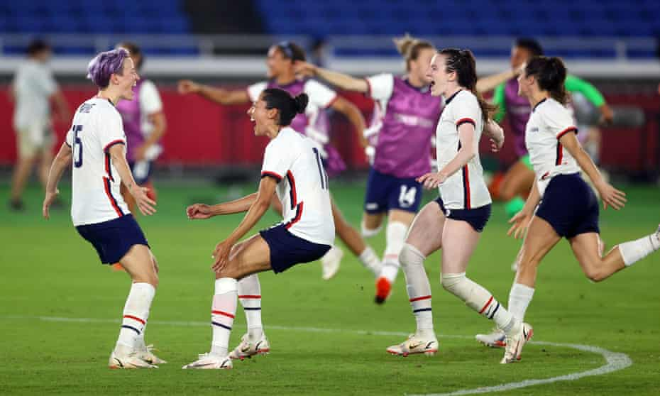 Megan Rapinoe celebrates with teammates after scoring the winning penalty against the Netherlands