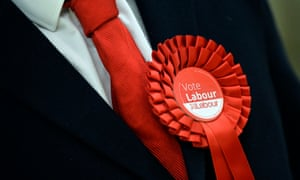 Labour supporter wears a rosette.