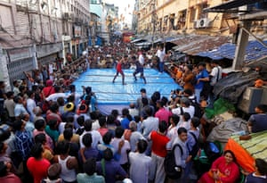 Wrestlers fight in a makeshift ring in Kolkata, India