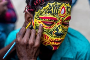 A Hindu boy's face is painted to celebrate Gajan, the Bengali New Year festival