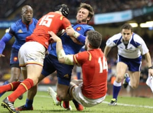 France's Maxime Medard is tackled by Liam Williams and Alex Cuthbert just short of the try-line.